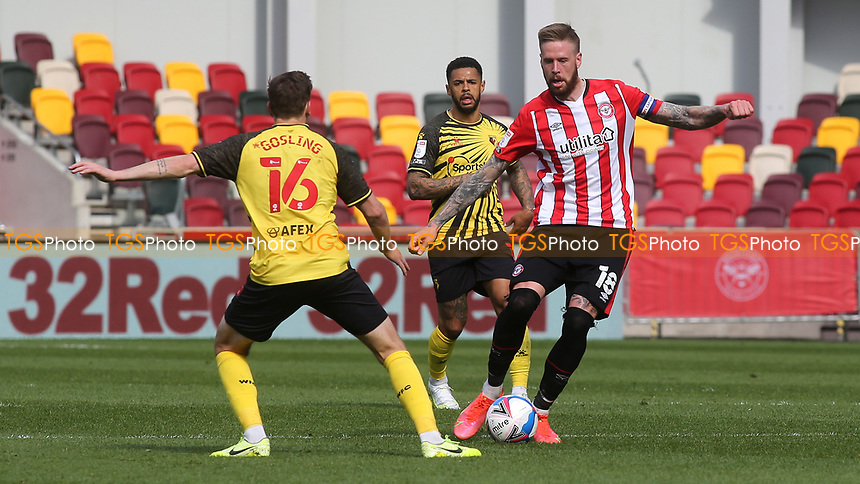 Pontus Jansson of Brentford dribbles the ball upfield during Brentford vs Watford, Sky Bet EFL Championship Football at the Brentford Community Stadium on 1st May 2021