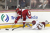 Michael Mersch (Wisconsin - 25), Quinn Smith (BC - 27) - The Boston College Eagles defeated the visiting University of Wisconsin Badgers 9-2 on Friday, October 18, 2013, at Kelley Rink in Conte Forum in Chestnut Hill, Massachusetts.