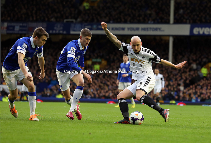 Pictured L-R: Seamus Coleman and John Stones against Jonjo Shelvey of Swansea. Saturday 22 March 2014<br /> Re: Barclay's Premier League, Everton v Swansea City FC at Goodison Park, Liverpool, UK.