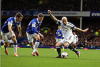 Pictured L-R: Seamus Coleman and John Stones against Jonjo Shelvey of Swansea. Saturday 22 March 2014<br />