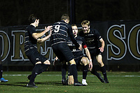 WINSTON-SALEM, NC - DECEMBER 07: Alistair Johnston #8 of Wake Forest University is surrounded by teammates after scoring a goal during a game between UC Santa Barbara and Wake Forest at W. Dennie Spry Stadium on December 07, 2019 in Winston-Salem, North Carolina.