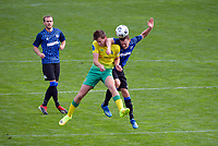 George Ott and Liam Wood contest a high ball during the Central League football match between Miramar Rangers and Lower Hutt AFC at David Farrington Park in Wellington, New Zealand on Saturday, 10 April 2021. Photo: Dave Lintott / lintottphoto.co.nz