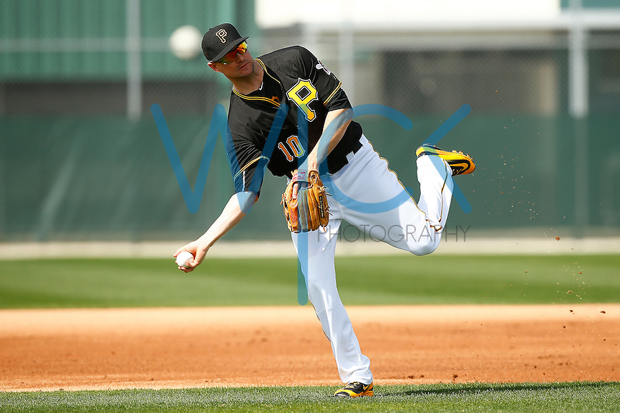 Jordy Mercer #10 of the Pittsburgh Pirates throws to first base during spring training at Pirate City in Bradenton, Florida on February 23, 2016. (Photo by Jared Wickerham / DKPS)