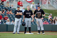 (L-R) Kannapolis Intimidators manager Ryan Newman (5), Andrew Vaughn (14), and Alex Destino (23) huddle at third base during a pitching change in the South Atlantic League game against the Augusta GreenJackets at SRG Park on July 6, 2019 in North Augusta, South Carolina. The Intimidators defeated the GreenJackets 9-5. (Brian Westerholt/Four Seam Images)