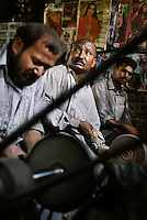 Workers grind knives in one of the thousands of such workshops in Wazirabad on the Grand Trunk Road. Traditionally an ancient centre for the making of metal weapons the town now specialises in making cutlery. A large proportion of it is sent for export.