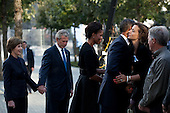 """Sept. 11, 2011.""""Former President George W. Bush and former First Lady Laura Bush wait as the President and First Lady greet family members and local dignitaries at the National September 11 Memorial in New York City on the tenth anniversary of the 9/11 attacks."""" .Mandatory Credit: Pete Souza - White House via CNP"""