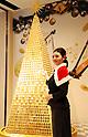 Tanaka Kikinzoku Jewelry diplays 3m tall Christmas tree consisting of gold coins
