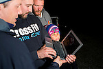 Mountain Lion (Puma concolor) biologists, Chris Wilmers, Chris Fust, Theo Wilmers, and Richie King, looking at camera trap footage, Santa Cruz Puma Project, Santa Cruz, Monterey Bay, California
