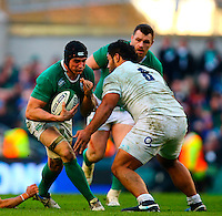 01.03.2015.  Dublin, Ireland. 6 Nations International Rubgy Championship. Ireland versus England.<br /> Tommy O'Donnell (Ireland) prepares to be tackled by Billy Vunipola (England).