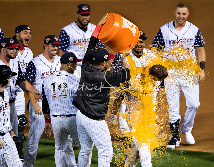 Members of the Charlotte Knights baseball team celebrate after Adam Engel drove in the winning run with a 3-2 walk-off win in front of a record-setting Independence Day crowd of 10,848 at BB&T Ballpark in Charlotte,, North Carolina.<br /> <br /> <br /> <br /> Charlotte Photographer - PatrickSchneiderPhoto.com