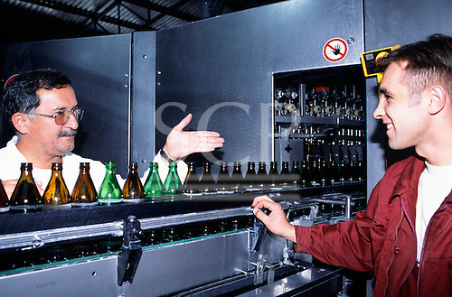 Sarajevo, Bosnia and Herzegovina.  Sarajevska Pivara - brewery; workers at the production line; empty beer bottles.