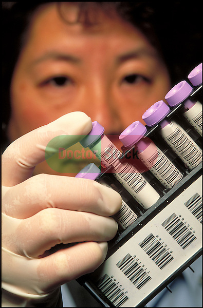 lab technician with blood samples