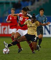 Crystal Dunn (USA) competes for the ball with Dzsenifer Marozsan (GER)..FIFA U17 Women's World Cup, Semi Final, Germany v USA, QEII Stadium, Christchurch, New Zealand, Thursday 13 November 2008. Photo: Renee McKay/PHOTOSPORT
