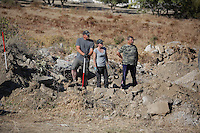 Pictured: Forensics officers conduct a preliminary search at the new site in Kos, Greece. Friday 07 October 2016<br />