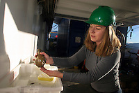 An archaeologist cleans an object just taken to the surface by the ROV. ©Fredrik Naumann/Felix Features