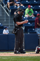 Home plate umpire Jacob Metz inspects a baseball during the game between the Rochester Red Wings and the Scranton/Wilkes-Barre RailRiders at PNC Field on July 25, 2021 in Moosic, Pennsylvania. (Brian Westerholt/Four Seam Images)
