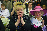 Moscow, Russia, 02/11/2011..The audience cheer their favourites at the first Moscow Super-Babushka contest. A total of 105 women aged over 50 entered to compete for various titles, including most stylish, modern, elegant, business-minded, creative, artistic, and cheerful granny. The overall winning title of Super-Babushka was taken by 73 year old Ludmilla Trafinovna in the event organised by the Moscow City Government Social Welfare Department.