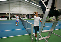 18-01-14,Netherlands, Rotterdam,  TC Victoria, Wildcard Tournament,  Fabian van der Lans (NED)  wins and walks up to the umpire, he defeats Ton Smit (NED)<br /> Photo: Henk Koster