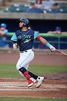 Andres Melendez (20) of the Lynchburg Hillcats follows through on his swing against the Myrtle Beach Pelicans at Bank of the James Stadium on May 22, 2021 in Lynchburg, Virginia. (Brian Westerholt/Four Seam Images)
