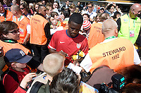 Eddie Johnson is mobbed by fans after training in Hamburg, Germany, for the 2006 World Cup, June, 6, 2006.