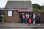 West Ham United 2 Crystal Palace 2, 02/04/2016. Boleyn Ground, Premier League. Home fans queueing for snacks at a refreshment stand at the Boleyn Ground after West Ham United hosted Crystal Palace in a Barclays Premier League match. The Boleyn Ground at Upton Park was the club's home ground from 1904 until the end of the 2015-16 season when they moved into the Olympic Stadium, built for the 2012 London games, at nearby Stratford. The match ended in a 2-2 draw, watched by a near-capacity crowd of 34,857. Photo by Colin McPherson.