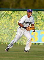 Timber Creek Wolves outfielder Eugene Vasquez #9 during warmups before a varsity baseball game against the Oak Ridge Pioneers at Timber Creek High School on February 19, 2013 in Orlando, Florida.  Vasquez is ranked as one of the top 100 draft prospects according to Baseball America and is committed to Central Florida.  (Mike Janes/Four Seam Images)