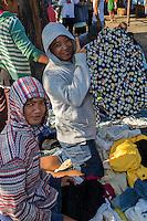 Jimbaran, Bali, Indonesia.  Used Clothing Vendor in Beach-side Market.