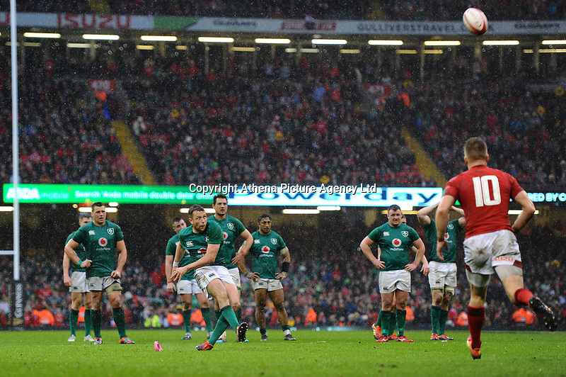 Pictured: Jack Carty of Ireland kicks his sides conversion during the Guinness six nations match between Wales and Ireland at the Principality Stadium, Cardiff, Wales, UK.<br /> Saturday 16 March 2019