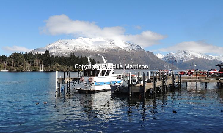 Queenstown, New Zealand - September 12, 2012:  Boats are docked in Queenstown Bay.