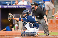 Catcher Robinson Chirinos #28 of the Durham Bulls sets a target as home plate umpire Fran Burke looks on during game two of a double header against the Charlotte Knights at Durham Bulls Athletic Park on August 28, 2011 in Durham, North Carolina.   (Brian Westerholt / Four Seam Images)