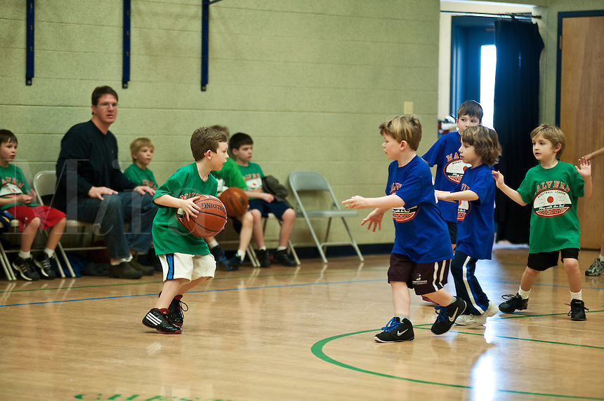 Boys pee wee basketball game.