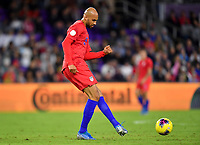ORLANDO, FL - NOVEMBER 15: John Brooks #5 of the United States passes off the ball during a game between Canada and USMNT at Exploria Stadium on November 15, 2019 in Orlando, Florida.