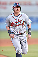 Rome Braves third baseman Austin Riley (13) runs to third during a game against the Asheville Tourists at McCormick Field on April 14, 2016 in Asheville, North Carolina. The Tourists defeated the Braves 5-4. (Tony Farlow/Four Seam Images)