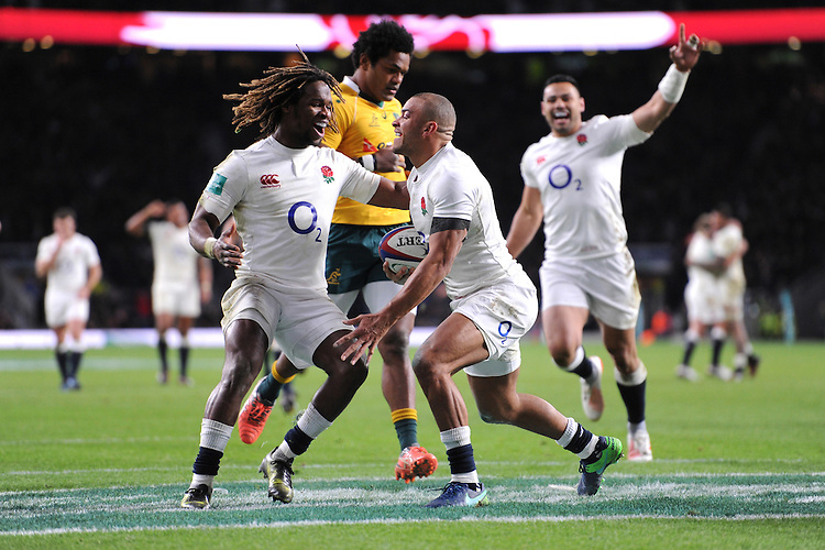 Marland Yarde of England congratulates Jonathan Joseph of England on scoring a try as Ben Te'o of England joins the party during the Old Mutual Wealth Series match between England and Australia at Twickenham Stadium on Saturday 3rd December 2016 (Photo by Rob Munro)