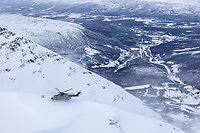 A British Merlin helicopter touch down during practice in the Arctic, in the mountains near Bardufoss, Norway. <br /> <br /> In 2019 the Arctic exercise Clockwork passed 50 years of training in Norway, and now has a permanent base within the Norwegian Air Force base at Bardufoss. <br /> <br /> 845 Naval Air Squadron is a squadron of the Royal Navy's Fleet Air Arm. Part of the Commando Helicopter Force, it is a specialist amphibious unit operating the Leonardo Commando Merlin Mk3 helicopter and provides troop transport and load lifting support to 3 Commando Brigade Royal Marines.<br /> <br /> ©Fredrik Naumann/Felix Features