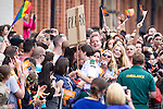 "© Joel Goodman - 07973 332324 . 23/08/2014 .  Manchester , UK . Erika Edwards , ambulance staff , receives a marriage proposal from the crowd . The parade through Manchester City Centre . Manchester Pride "" Big Weekend "" in Manchester "" today ( 23rd August 2014 ) . Photo credit : Joel Goodman"