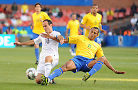 Gilberto Silva of Brzail and Landon Donovan of USA. Brazil defeated USA 3-0 during the FIFA Confederations Cup at Loftus Versfeld Stadium in Tshwane/Pretoria, South Africa on June 18, 2009.