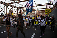 NEW YORK, USA - May 25: Protesters in support of Black Lives Matteren protest on the Brooklyn Bridge on the first anniversary of the death on May 25, 2021 in New York City. George Floyd's assassination in Minneapolis sparked a worldwide outcry and continued to propel the Black Lives Matter movement through different cities in the United States and the world. (Photo by Pablo Monsalve / VIEWpress via Getty Images)