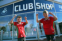 Pictured L-R: Ryan, 9 and brother Scott, 10 Phillips. Saturday 01 July 2017<br /> Re: The new 2017-2018 season, Swansea City FC kit has officially gone on sale at the club's Liberty Stadium shop, Wales, UK