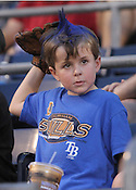 A young Durham Bulls fan watches the game from the thrid base side. The Durham Bulls face the Gwinnett Braves in a four-game, two-city series during Independence Weekend. Photo by Al Drago.