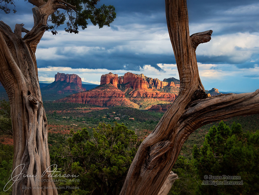 Courthouse and Cathedral.  On this late summer afternoon, the Sedona sky couldn't quite decide whether to be stormy or just cloudy, but it occasionally sent some nice sunbeams onto the red rocks of Courthouse Butte and Cathedral Rock.  There were no complaints from me!<br /> <br /> Image ©2021 James D. Peterson<br /> <br /> Tech info: Nikon D850 camera with Nikon 28-300mm lens at 50mm, 1/125 sec. at f16, ISO 500.