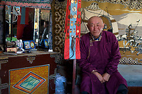 Dushuluun, nomad man in his yurt, with medals.