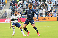 KANSAS CITY, KS - MAY 16: Khiry Shelton #11 Sporting KC with the ball during a game between Vancouver Whitecaps and Sporting Kansas City at Children's Mercy Park on May 16, 2021 in Kansas City, Kansas.