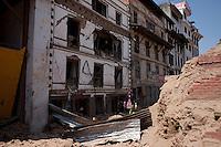 A Nepali woman saves her belongings from her destroyed house at Kathmandu Durbar Square, Kathmandu, Nepal. May 03, 2015