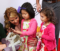 """LOS ANGELES, CA - JANUARY 11: Katherine Heigl and daughters Nancy Leigh Kelley and Adalaide Marie Hope Kelley arrive at the World Premiere Of Open Road Film's """"The Nut Job"""" held at Regal Cinemas L.A. Live on January 11, 2014 in Los Angeles, California. (Photo by Xavier Collin/Celebrity Monitor)"""