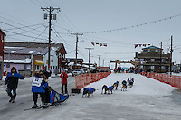 Cindy Gallea runs down Front Street into the finish chute in Nome on Sunday  March 22, 2015 during Iditarod 2015.  <br /> <br /> (C) Jeff Schultz/SchultzPhoto.com - ALL RIGHTS RESERVED<br />  DUPLICATION  PROHIBITED  WITHOUT  PERMISSION