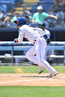 Asheville Tourists Korey Lee (5) runs to first base during a game against the Greenville Drive on May 23, 2021 at McCormick Field in Asheville, NC. (Tony Farlow/Four Seam Images)