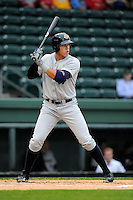 Aaron Judge (35) of the Charleston RiverDogs bats in a game against the Greenville Drive on Monday, April 14, 2014, at Fluor Field at the West End in Greenville, South Carolina. Judge is the No. 6 prospect of the New York Yankees, according to Baseball America. Charleston won, 11-3. (Tom Priddy/Four Seam Images)