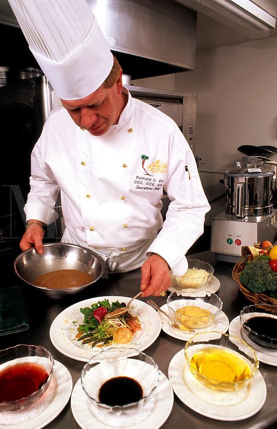 Chef preparing fine meal in upscale restaurant