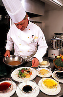Chef preparing fine meal in upscale restaurant